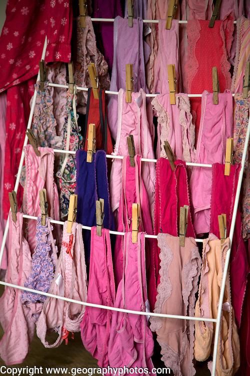 Women's underwear drying indoors