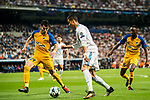 Cristiano Ronaldo (c) of Real Madrid competes for the ball with Praxitellis Vouros of APOEL FC during the UEFA Champions League 2017-18 match between Real Madrid and APOEL FC at Estadio Santiago Bernabeu on 13 September 2017 in Madrid, Spain. Photo by Diego Gonzalez / Power Sport Images