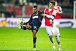 Nederland,Alkmaar, 8 december  2012.Eredivisie.Seizoen 2012/2013.AZ_Willem II.Sofian Akouili van Willem ll in duel om de bal met Johann Berg Gudmundsson van AZ