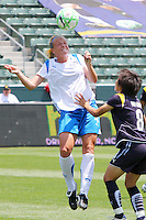 Stacy Bishop #4 of the Boston Breakers heads a loose ball over Aya Miyama #8 of the Los Angeles Sol during their WPS match at Home Depot Center on May 10, 2009 in Carson, California.