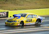 Sept. 21, 2012; Ennis, TX, USA: NHRA pro stock driver Jeg Coughlin during qualifying for the Fall Nationals at the Texas Motorplex. Mandatory Credit: Mark J. Rebilas-