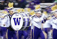 The Husky Band is a blur of movement and color during their halftime show.