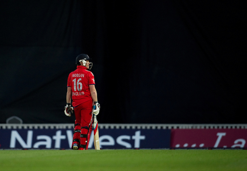 England's Eoin Morgan looks back at the large screen to see the spectacular catch by New Zealand's Ross Taylor<br /> <br />  (Photo by Ashley Western/CameraSport) <br /> <br /> International Cricket - NatWest International T20 Series - England v New  Zealand - Tuesday 25th June 2013 - The Kia Oval, London <br /> <br />  &copy; CameraSport - 43 Linden Ave. Countesthorpe. Leicester. England. LE8 5PG - Tel: +44 (0) 116 277 4147 - admin@camerasport.com - www.camerasport.com