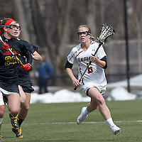 Boston College midfielder Sarah Mannelly (6) brings the ball forward. .University of Maryland (black) defeated Boston College (white), 13-5, on the Newton Campus Lacrosse Field at Boston College, on March 16, 2013.