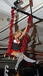 Sarah Goodman swings above the crowd at the Orange Show Gala at Adickes SculpturWorx Studio  Saturday  Nov. 03,2007.(Dave Rossman/For the Chronicle)