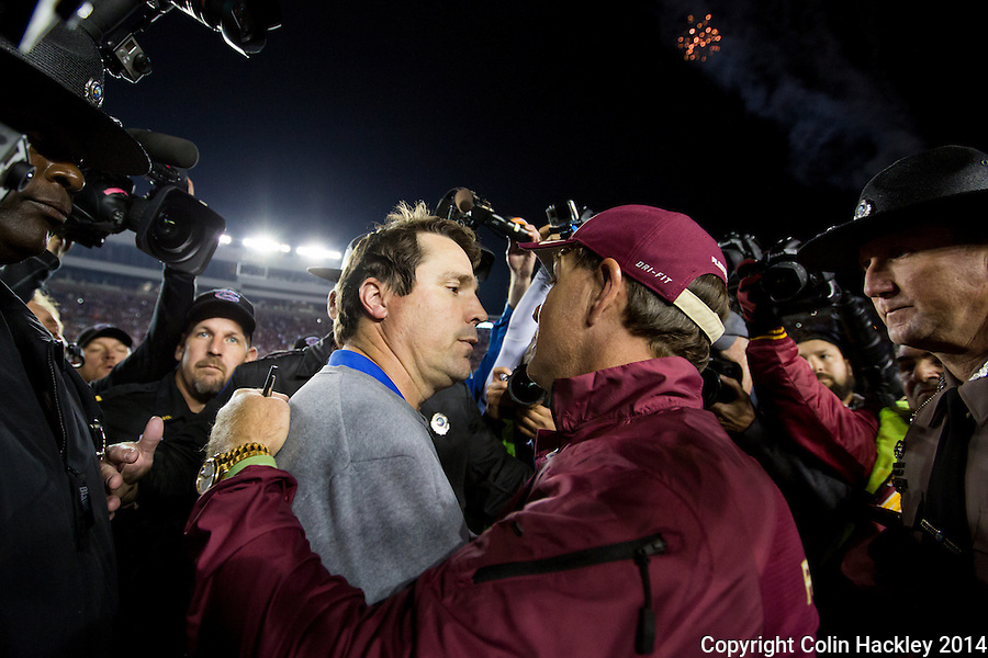 TALLAHASSEE, FL 11/29/14 FSU-UF112914-Florida Head Coach Will Muschamp, left, meets Florida State University Head Coach Jimbo Fisher at the close of the game after the Seminoles beat the Gators 24-19.<br /> Saturday at Doak Campbell Stadium in Tallahassee. It was Muschamp's last game as head coach of Florida.<br /> COLIN HACKLEY PHOTO