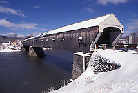 covered bridge, Vermont/New Hampshire, VT/NH, Windsor-Cornish Covered Bridge crosses over the Connecticut River in the snow in winter.
