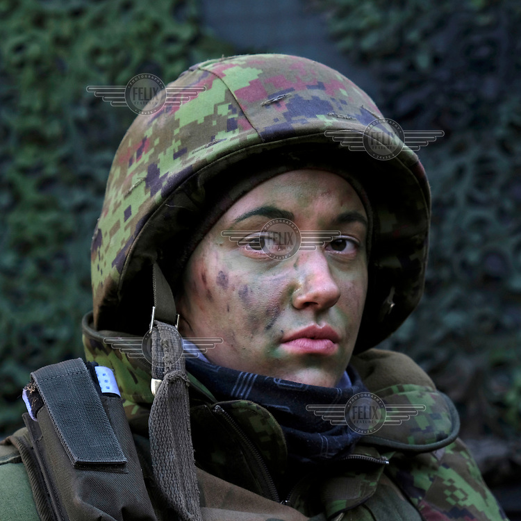 Lisa Rohila, a Kaitseliit ('Defence League') volunteer who works in the office of the President. The Kaitseliit is a paramilitary force made up of civilian volunteers instructed and commanded by professional military officers. Rohila's unit is taking part in the 'Spring Storm', military exercises involving the Estonian army and NATO forces under a UK commander.