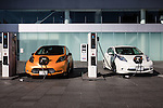 February 10, 2016, Yokohama, Japan - Nissan zero emissions vehicles are seen at a charging station outside of the Nissan Motor Company Ltd. showroom in Yokohama, south of Tokyo. Nissan booked a 34 percent rise in the company's group net profit to 452.8 billion yen and sold a total of 3,891,000 vehicles worldwide during the April-December 2015 period. (Photo by AFLO)