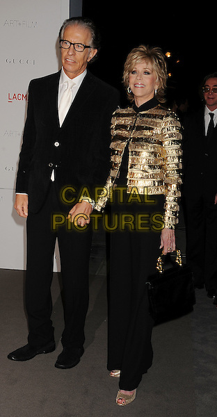 Richard Perry, Jane Fonda.The Inaugural Art and Film Gala held at LACMA in Los Angeles, California, USA..November 5th, 2011.full length jacket suit shirt glasses black gold holding hands couple trousers.CAP/ROT/TM.©Tony Michaels/Roth Stock/Capital Pictures