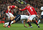 Harry Kane of Tottenham gets caught between Ander Herrera of Manchester United and Marcos Rojo of Manchester United during the English Premier League match at Old Trafford Stadium, Manchester. Picture date: December 11th, 2016. Pic Simon Bellis/Sportimage