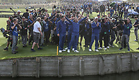 Photographers surround the victorious European players after the Sunday's Singles, at the Ryder Cup, Le Golf National, Île-de-France, France. 30/09/2018.<br /> Picture David Lloyd / Golffile.ie<br /> <br /> All photo usage must carry mandatory copyright credit (© Golffile | David Lloyd)