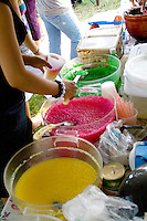 Colorful bowls of food served at the food concession stand. Hmong Sports Festival McMurray Field St Paul Minnesota USA