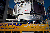 A  sightseeing bus passes in front of Toronto Eaton Centre in Toronto April 19, 2010. The Toronto Eaton Centre is a large shopping mall and office complex in Downtown Toronto, Ontario, Canada, named after the now-defunct Eaton's department store chain that once anchored it.