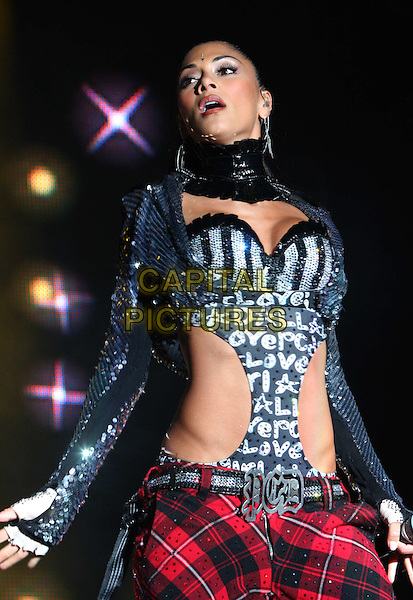 PUSSYCAT DOLLS- NICOLE SCHERZINGER.performing after racing at the Silverstone Classic meeting at Silverstone Racetrack, Northamptonshire, England 24th July 2009.playing live on stage gig concert performance music half length black sequins sequined red tartan plaid cut out away top jacket mouth open.CAP/ROS.©Steve Ross/Capital Pictures.