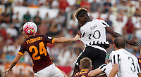 Calcio, Serie A: Roma vs Juventus. Roma, stadio Olimpico, 30 agosto 2015.<br /> Roma&rsquo;s Alessandro Florenzi, left, and Juventus&rsquo; Paul Pogba jump for the ball during the Italian Serie A football match between Roma and Juventus at Rome's Olympic stadium, 30 August 2015.<br /> UPDATE IMAGES PRESS/Isabella Bonotto