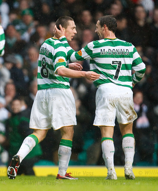 Scott McDonald congratulates goalscorer Scott Brown