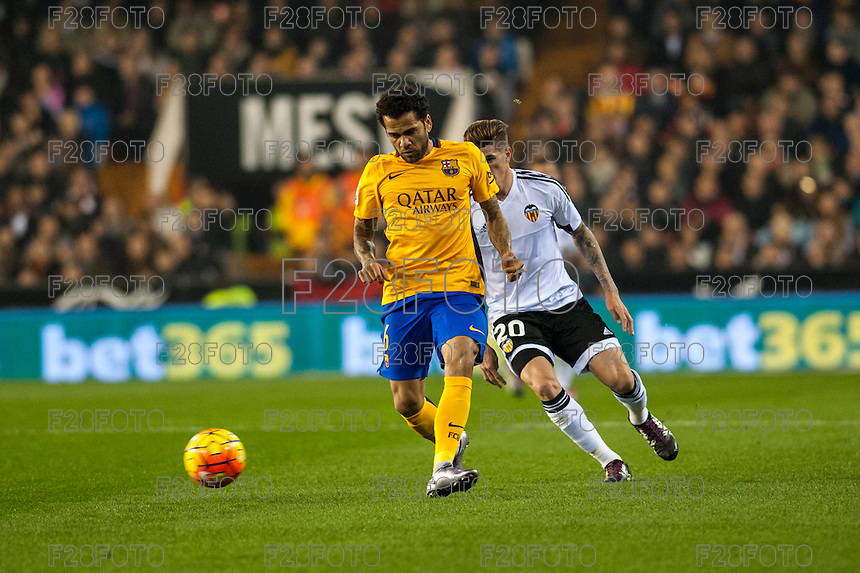 VALENCIA, SPAIN - DECEMBER 5: Dani Alves and De Paul during BBVA LEAGUE match between Valencia C.F. and FC Barcelona at Mestalla Stadium on December 5, 2015 in Valencia, Spain