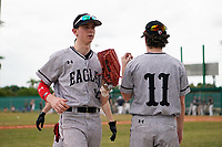 Edgewood Eagles right fielder Casey Willis (10) is greeted by Connor Schatzberg (11) during the first game of a double header against the Bethel Wildcats on March 15, 2019 at Terry Park in Fort Myers, Florida.  Bethel defeated Edgewood 6-0.  (Mike Janes/Four Seam Images)