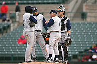 April 15th, 2007:  The Charlotte Knights, Class-AAA affiliate of the Chicago White Sox, have a conference on the mound while waiting for a new pitcher vs. the Rochester Red Wings at Frontier Field in Rochester, NY.  From left:  Pedro Lopez (14), Kenny Perez (18), Manager Marc Bombard (13), and Catcher Ryan Smith (27).  Photo by:  Mike Janes/Four Seam Images