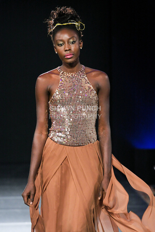 Model walks runway in a SiSa Designs Fall 2011 outfit, by Simone Rodrigues, during Couture Fashion Week Fall 2011.