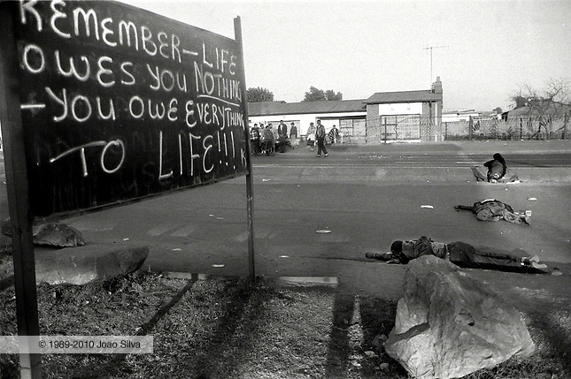 Three dead men lie in the street at dawn in Dobsonville, Soweto, where they were gunned down during a battle between Inkatha and the ANC in Soweto's Dobsonville suburb. 1992.