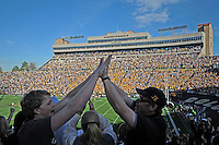 07 November 2009: A pair of Colorado fans high-five one another as the Buffaloes ensure a victory on a play during a Big XII conference game between the Texas A&M Aggies and the University of Colorado Buffaloes at Folsom Field in Boulder, Colorado. The Buffs beat the Aggies 35-34.  *****For editorial use only*****