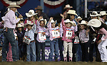 The Mutton Bustin' contestants wave to the crowd at the Reno Rodeo on Friday, June 17, 2011..Photo by Cathleen Allison