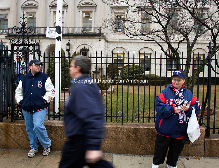 WATERBURY--11 January 07--011108TJ06 - Bryan St. John, left, and Concetta Dilger, right, both from Waterbury, donned their Red Sox gear to wait at Waterbury City Hall to see the Red Sox 2004 and 2007 World Series trophies on Friday, January 11, 2008. (T.J. Kirkpatrick/Republican-American)