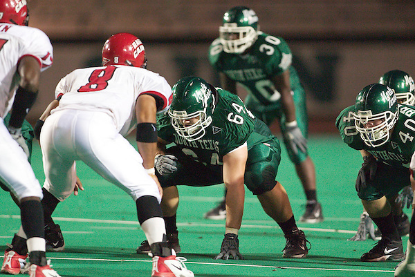 DENTON, TX  SEPTEMBER 27 :  Jason May #64 - North Texas Mean Green Football vs Ricky Calais #8 -  Louisiana Lafayette Ragin Cajuns at Fouts Field in Denton on September 27, 2003 in Denton, NT won 44-23. Photo by Rick Yeatts