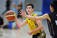 Wellington's Mitchell McDonald in action during the National Under-15 Basketball Championship at the ASB Sports Centre, Kilbirnie, Wellington, New Zealand on Thursday, 25 July 2013. Photo: Dave Lintott / lintottphoto.co.nz