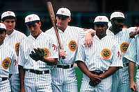 SAN FRANCISCO, CA - Matt Williams (center with bat) of the San Francisco Giants poses for a team picture with Mike Benjamin, Kirt Manwaring and Kevin Bass before a turn back the clock game against the Chicago Cubs at Candlestick Park in San Francisco, California in 1991. Photo by Brad Mangin