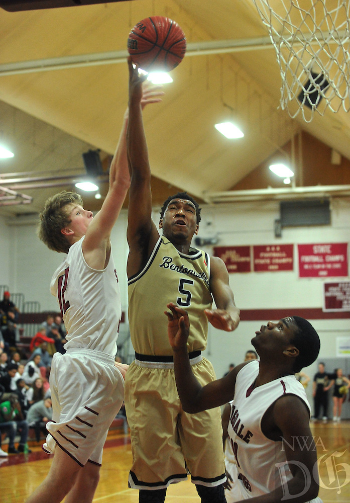 NWA Democrat-Gazette/MICHAEL WOODS • @NWAMICHAELW<br /> Bentonville's Malik Monk (5) has his shot blocked by  Springdale defender Jack Lyndsey (12) as he tries to drive to the hoop Tuesday February 16, 2016 at Springdale High School.