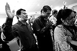 Salt Lake City, UT--8/27/06--&amp;#xA;While singing praise songs, Victor and Augustine Jimenez become emotional during the Spanish-speaking worship service held at the Christian Life Center.<br />