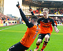 Dundee Utd's Nadir Ciftci celebrates with Chris Erskine after he scores their first goal.