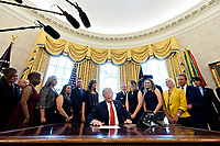 United States President Donald Trump, center, speaks while meeting with the crew and passengers of Southwest Airlines Co. flight 1380 in the Oval Office of the White House in Washington, D.C., U.S., on Tuesday, May 1, 2018. An engine on Southwest's flight 1380, a Boeing Co. 737-700 bound for Dallas from New York's LaGuardia airport, exploded and made an emergency landing on April 17 sending shrapnel into the plane and killing a passenger seated near a window. <br /> Credit: Andrew Harrer / Pool via CNP /MediaPunch