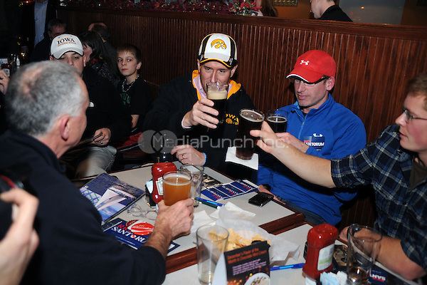 Rick Santorum drinks beers with supporters as he hosts an Insight Bowl Watch Party at Okoboji Grill in Johnston, Iowa while campaigning for the Iowa Caucuses. December 30, 2011.© mpi01/MediaPunch Inc.