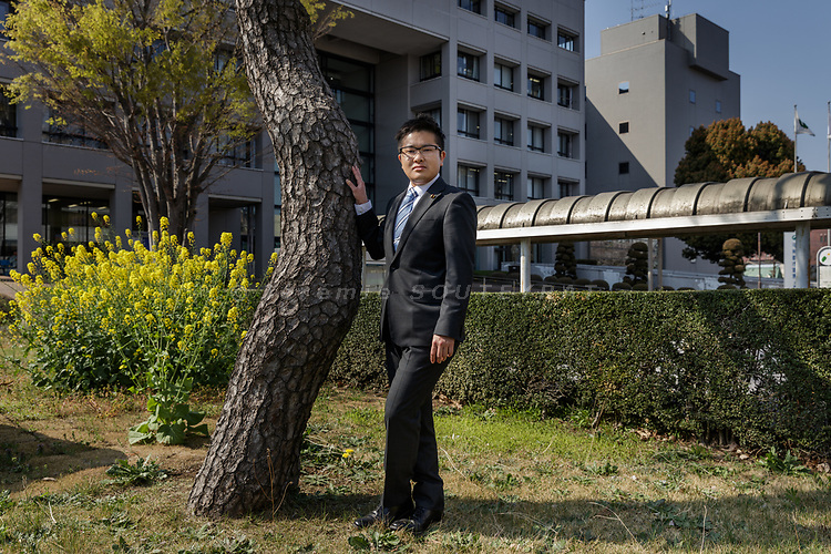 Iruma city, Saitama prefecture, Japan, April 14 2017 - Portrait of Tomoya HOSODA in front of Iruma city hall. <br /> Tomoya HOSODA is the first out transgender man to be elected to a public office. He was elected a councillor in the city of Iruma in March 2017. Mr Hosoda officially changed his name and gender in the family registry in 2015 after having come out and transitioned.