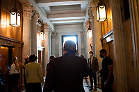 Senators depart Senate Chamber following a vote