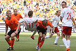14 JUN 2010: John Heitinga (NED) (2nd from left) receives a cut on the head from the elbow of Nicklas Bendtner (DEN) (11) as Dirk Kuyt (NED) (7) and Thomas Enevoldsen (DEN) (20) watch. The Netherlands National Team defeated the Denmark National Team 2-0 at Soccer City Stadium in Johannesburg, South Africa in a 2010 FIFA World Cup Group E match.