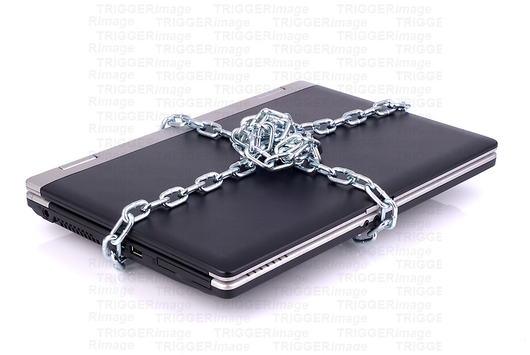 A black laptop computer tied up in chains