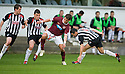 HEARTS' RUDI SKACEL GETS PAST THREE DUNFERMLINE PLAYERS