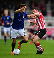 Crewe Alexandra's Perry Ng shields the ball from Lincoln City's Shay McCartan<br /> <br /> Photographer Chris Vaughan/CameraSport<br /> <br /> The EFL Sky Bet League Two - Lincoln City v Crewe Alexandra - Saturday 6th October 2018 - Sincil Bank - Lincoln<br /> <br /> World Copyright &copy; 2018 CameraSport. All rights reserved. 43 Linden Ave. Countesthorpe. Leicester. England. LE8 5PG - Tel: +44 (0) 116 277 4147 - admin@camerasport.com - www.camerasport.com