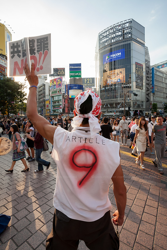 """A small protest against the revision of Article 9 in the Japanese constitution in Hachiko Square, Shibuya, Tokyo, Japan. Friday June 23rd 2017 Right-wing Japanese Prime Minister Shinzo Abe, is determined to revise Article 9, which forbids Japan from waging wars of aggression, so that japan can take part in international military operations with allies and have a proper military force. The essential article of Japan's unique post-war """"Peace Constitution"""" is very popular with Japanese citizens however."""