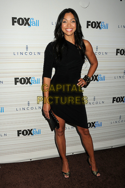 TAMARA TAYLOR .Fox Fall Eco-Casino Party 2010 held at BOA Steakhouse, West Hollywood, California, USA, 13th September 2010..full length one shoulder black dress hand on hip Sleeve .CAP/ADM/BP.©Byron Purvis/AdMedia/Capital Pictures.