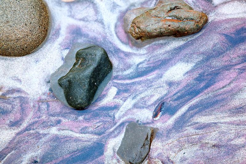 Small stream with purple sand. Big Sur Coast. California