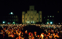 Crowd scene at night of people caroling in Jackson Square with candles. New Orleans, Louisiana.
