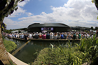 A general view of spectators watching the big screen on the hill<br /> <br /> Photographer Rob Newell/CameraSport<br /> <br /> Wimbledon Lawn Tennis Championships - Day 3 - Wednesday 3rd July 2019 -  All England Lawn Tennis and Croquet Club - Wimbledon - London - England<br /> <br /> World Copyright © 2019 CameraSport. All rights reserved. 43 Linden Ave. Countesthorpe. Leicester. England. LE8 5PG - Tel: +44 (0) 116 277 4147 - admin@camerasport.com - www.camerasport.com