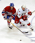 6 February 2007: Carolina Hurricanes center and team captain Rod Brind'Amour (17) jostles with Montreal Canadiens right wing forward Alexei Kovalev (27) of Russia for control of the puck at the Bell Centre in Montreal, Canada. The Hurricanes defeated the Canadiens 2-1.....Mandatory Photo Credit: Ed Wolfstein *** Editorial Sales through Icon Sports Media *** www.iconsportsmedia.com
