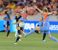Vanessa DiBernardo (10) of the Chicago Red Stars clears the ball from her side of the field in the second half as Becca Moros (4) of the Houston Dash attempts to block the vick on Saturday, April 16, 2016 at BBVA Compass Stadium in Houston Texas.